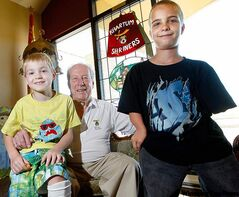 KEN GIGLIOTTI / WINNIPEG FREE PRESS Rylan Bilaski (left), 7, and Matthew Reimer, 13, with Khartum Shriners Hospital chairman Craig Houston.