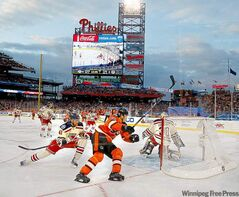 The Philadelphia Flyers' Jaromir Jagr (68) skates around the net trying to get to the puck during the 2012 Winter Classic game against the New York Rangers.