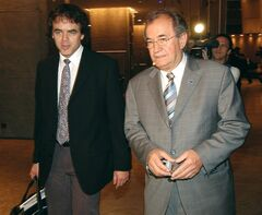 CAW president Buzz Hargrove, accompanied by CAW's staff economist Jim Stanford, arrives at a Toronto hotel Thursday, May 20, 2004 with Air Canada. Wage levels in Canada are generally in line with those in the United States, says an internal government study, suggesting the pay packets of Canadian workers pose no special competitive disadvantage. THE CANADIAN PRESS/Derek Oliver
