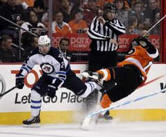 Philadelphia Flyers Brayden Schenn, right, goes down hard after a check from Winnipeg Jets Grant Clitsome in the second period of an NHL hockey game Saturday, in Philadelphia. The Flyers won 5-3.