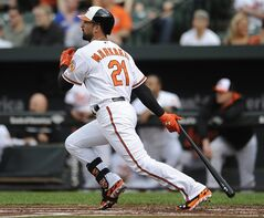 Baltimore Orioles' Nick Markakis follows through on a single against the Cleveland Indians in the first inning of a baseball game, Thursday, May 22, 2014, in Baltimore. (AP Photo/Gail Burton)