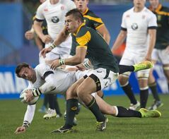 England halfback Henry Taylor, is tackled by South Africa's Handre Pollard during the IRB Junior World Championship Final at Eden Park in Auckland, New Zealand Friday, June 20, 2014. (AP Photo/New Zealand Herald, Brett Phibbs) AUSTRALIA OUT, NEW ZEALAND OUT