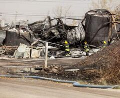 Firefighters continued to put out hotspots at the site of the Speedway International fire in St. Boniface midday on Tuesday.