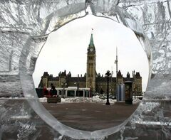 Parliament Hill is seen through an ice sculpture.