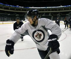 Winnipeg Jets player Kyle Wellwood joined in at an informal practice in the MTS Centre this morning.