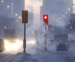 Icy exhaust fog fills the air along Notre Dame Avenue on a cold -30 C Thursday morning.