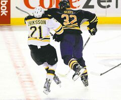 Buffalo enforcer John Scott was suspended for seven games for this hit on Boston's Loui Eriksson.