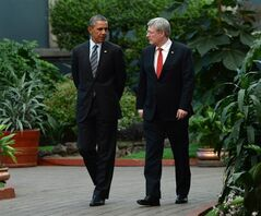 Prime Minister Stephen Harper walks with U.S. President Barack Obama during the North American Leaders Summit in Toluca, Mexico on Wednesday, Feb.19, 2014. Harper and Obama have a couple of cases of beer riding on the outcome of the men's and women's games in Olympic hockey.THE CANADIAN PRESS/Sean Kilpatrick
