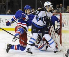 New York Rangers' Michael Del Zotto loses his balance as he is checked by Winnipeg Jets' Antti Miettinen during the first period of an NHL game at Madison Square Garden in New York on Monday. The Rangers won 4-2.