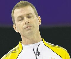 Manitoba skip Jeff Stoughton reacts to a shot during the gold medal draw against Northern Ontario at the Tim Hortons Brier in Edmonton.