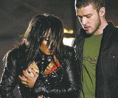 Entertainer Janet Jackson, left, covers her breast after her outfit came undone during the half time performance with Justin Timberlake  at Super Bowl XXXVIII between the Carolina Panthers and New England Patriots  in Houston, Sunday Feb. 1, 2004.