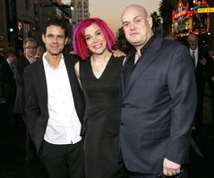 Co-directors Tom Tykwer, Lana Wachowski and Andy Wachowski pose for reporters at the Los Angeles premiere of