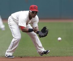 Cleveland Indians' Jose Ramirez fields a ball hit by Baltimore Orioles' Nick Markakis in the first inning of a baseball game, Sunday, Aug. 17, 2014, in Cleveland. Markakis was out on the play. (AP Photo/Tony Dejak)