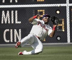 Philadelphia Phillies' Marlon Byrd makes the catch for an out on a fly ball by the Washington Nationals' Sandy Leon in the seventh inning of a baseball game, Sunday, May 4, 2014, in Philadelphia. Phillies won 1-0. (AP Photo/Laurence Kesterson)