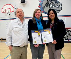 Principal Michel Chartrand (left), Westdal, and acting principal Joyce Wong celebrate Westdal receiving the Prime Minister's Award for Teaching Excellence.