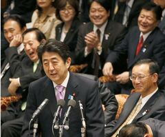 Cabinet ministers and ruling coalition lawmakers laugh at Japanese Prime Minister Shinzo Abe's joke during Friday's session at Lower House Budget Committee in Tokyo March 8, 2013. Japan's economy did better than first thought in the last quarter of 2012, eking out a slight expansion instead of shrinking in a boost for Abe's policies to end two decades of deflationary stagnation. (AP Photo/Kyodo News) JAPAN OUT, MANDATORY CREDIT, NO LICENSING IN CHINA, HONG KONG, JAPAN, SOUTH KOREA AND FRANCE