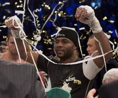 Jean Pascal celebrates after defeating Lucian Bute, on January 18, 2014 in Montreal. THE CANADIAN PRESS/Ryan Remiorz
