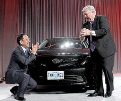 Toyota president Akio Toyoda , left, and Mississippi Gov. Haley Barbour celebrate the unveiling of a new auto tag faceplate on the first Corolla built in that state.