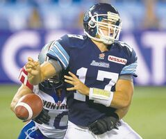 Toronto Argonauts quarterback Zach Collaros loses the ball as he is drilled by Montreal Alouettes linebacker Marc-Olivier Brouillette on Tuesday night.