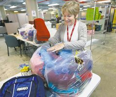 Claire Friesen sorts donations at the donor-care office at Siloam Mission.