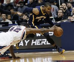 Atlanta Hawks power forward Elton Brand (42) tries to steal the ball from Indiana Pacers point guard C.J. Watson (32) during the first half of an NBA basketball game Wednesday, Jan. 8, 2014, in Atlanta, (AP Photo/John Bazemore)