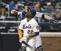 New York Mets' Eric Young Jr. (22) reacts as New York Yankees catcher Brian McCann throws the ball back to the pitcher after Young struck out looking with Bobby Abreu on first in the eighth inning of a baseball game in New York, Thursday, May 15, 2014. (AP Photo/Kathy Willens)