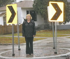Michelle Taylor at the traffic circle located at the intersection of Roch Street and Leighton Avenue.