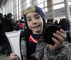 Alex Ranieri, 5, caught a puck from Tim Stapleton when he came to see the Winnipeg Jets take on the St. Louis Blues, Saturday.