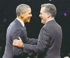 U.S. President Barack Obama shakes hands with Republican rival Mitt Romney during the first presidential debate at the University of Denver Wednesday.