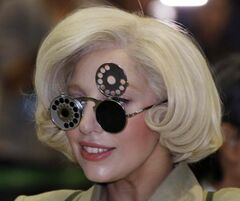 Lady Gaga, wearing sunglasses, smiles as she is greeted by fans upon her arrival at Narita International Airport in Narita, east of Tokyo, last month. Gaga is in Japan to promote her new album ARTPOP.