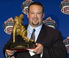 Montreal Alouettes Scott Flory holds his trophy for Outstanding Offensive Lineman at the CFL awards in Montreal on Nov. 20 2008. A longtime and successful leader in the Montreal Alouettes' dressing room, Scott Flory has decided that he has to hang up his cleats in order to fully dedicate himself to his new role on behalf of all CFL players. THE CANADIAN PRESS/Nathan Denette
