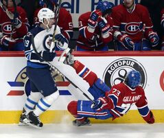Winnipeg Jets centre Jim Slater flattens Montreal Canadiens winger Brendan Gallagher during the first period of an NHL game at the Bell Centre in Montreal Tuesday.