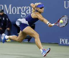 Sabine Lisicki, of Germany, stretches to return a shot to Maria Sharapova, of Russia, during the third round of the U.S. Open tennis tournament Friday, Aug. 29, 2014, in New York. (AP Photo/Jason DeCrow)
