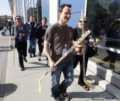 (Front) Kevin McDonald and Carrie O'Neill, along with Melanie Wesley, Tom Jankowski  and Sherri Hollup (back) picked up free Canadian Tire hockey sticks downtown today.