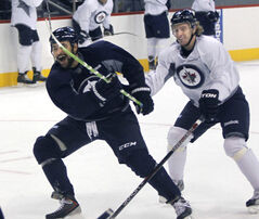 Winnipeg Jets Dustin Byfuglien (left) and Bryan Little do some horsing around in an informal practice at the MTS Centre Friday.
