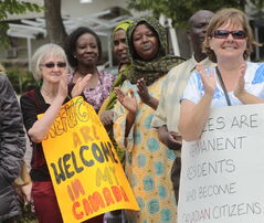 Karen Giesbrecht (left) and dozens of others 'walk with refugees for a stronger Canada.'