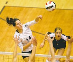 River East Kodiak Emily Loewen goes up over Crocus Plains Plainsmen defenders to hammer down a kill.