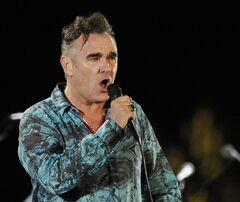 FILE - In this April 17, 2009 file photo, Morrissey performs during the first day of the Coachella Valley Music & Arts Festival in Indio, Calif. Morrissey has canceled the rest of his U.S. tour to recover from a respiratory infection that has worsened. His representative said in a statement Tuesday, June 10, 2014, the 55-year-old singer wants to make a full recovery and has to withdraw from the shows. (AP Photo/Chris Pizzello, file)