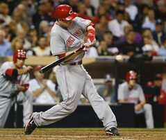 Cincinnati Reds' Todd Frazier connects for a base hit that drives in Zack Cozart for a Reds' run in the fifth inning of a baseball game against the San Diego Padres, Tuesday, July 1, 2014, in San Diego. (AP Photo/Lenny Ignelzi)