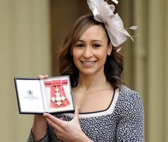 Olympic heptathlon champion Jessica Ennis poses for the media after she received her Commander of the British Empire (CBE) medal from Queen Elizabeth II during an Investiture ceremony at Buckingham Palace in London, Thursday Feb. 28, 2013. Ennis is among a number of British gold medal winners from the recent London 2012 Olympic Games to be honored by the Queen in recognition of their sporting achievements. (AP Photo / Jonathan Brady, PA) UNITED KINGDOM OUT - NO SALES - NO ARCHIVES