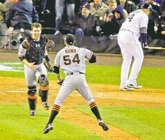 San Francisco Giants catcher Buster Posey and closer Sergio Romo celebrate as Detroit Tigers third baseman Miguel Cabrera sulks on his way to the dugout after striking out to end the World Series.