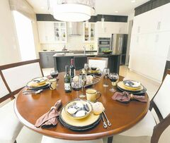 A large dinette area is situated between the kitchen and family room.