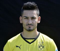 "In this picture taken July 9, 2013, Borussia Dortmund's Ilkay Gundogan poses during a team photo shooting in Dortmund, Germany. Borussia Dortmund says midfielder Ilkay Gundogan has undergone a back operation after missing most of last season through injury and should be able to make his comeback in three months' time. Dortmund said Wednesday June 19, 2014 that Gundogan, whose injury problems ruled him out of Germany's World Cup campaign, had ""minimally invasive"" surgery in Munich earlier this week.(AP Photo/Martin Meissner,file)"