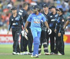 India's Rohit Sharma looks back after being dismissed by New Zealand's Tim Southee for 20 in the second one day International cricket match at Seddon Park in Hamilton, New Zealand, Wednesday, Jan. 22, 2014. (AP Photo/SNPA, Ross Setford) NEW ZEALAND OUT