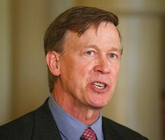 FILE - Colorado Gov. John Hickenlooper speaks at a news conference at the Capitol in Denver in this Wednesday, May 22, 2013 file photo. Hickenlooper Saturday afternoon May 17, 2014 will sign Colorado's