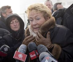Quebec Premier Pauline Marois speaks to the media as L'Isle-Verte Mayor Ursule Theriault, left, looks on after a visit to the site of the fatal fire at a seniors residence, Sunday, January 26, 2014 in L'Isle-Verte, Que. THE CANADIAN PRESS/Ryan Remiorz