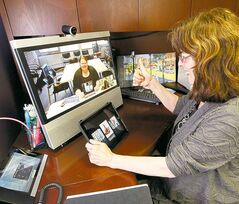 Allison Baird of SpeechWorks Inc. helps stroke patients by using a computer link and iPad.