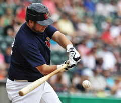 Winnipeg Goldeyes' Casey Haerther (12) hits a foul ball