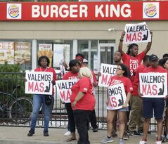 Protesters demonstrate at a rally outside a Burger King in Chicago as labor organizers escalate their campaign to unionize the industry's workers, Thursday, Sept. 4, 2014. THE CANADIAN PRESS/AP, M. Spencer Green
