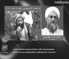 Ayman al-Zawahiri (right) gives a eulogy for a slain Taliban commander in this 2007 file image.
